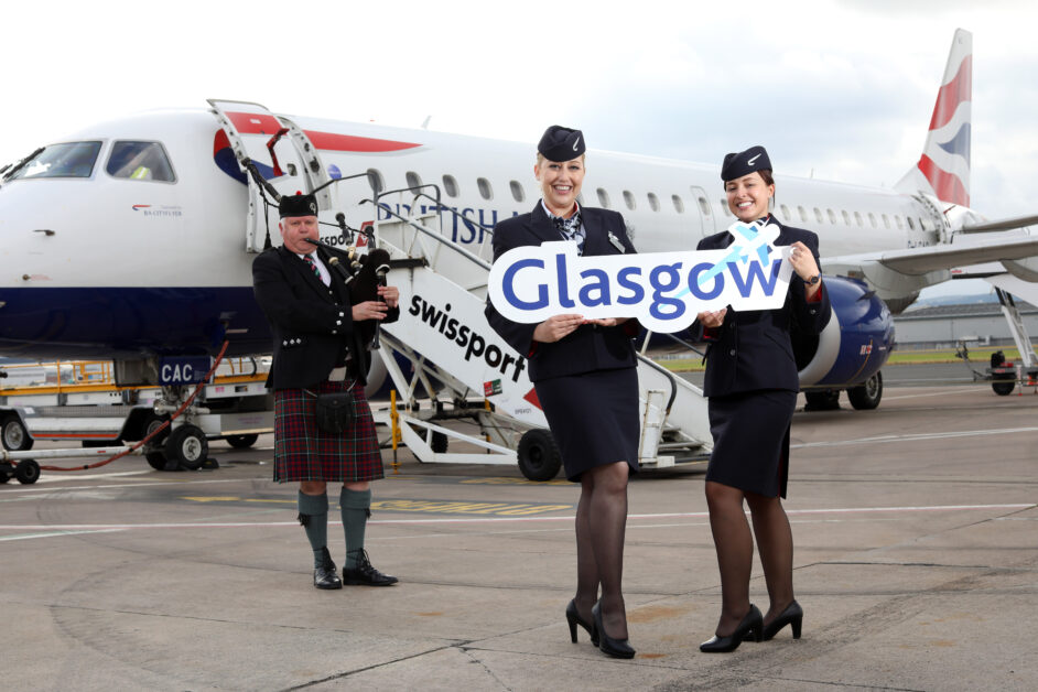 Flights to Glasgow have commenced from Belfast City Airport. Pictured with a bagpiper to mark the occasion are British Airways cabin crew Lucienne McCarthy and Laura Richardson 1